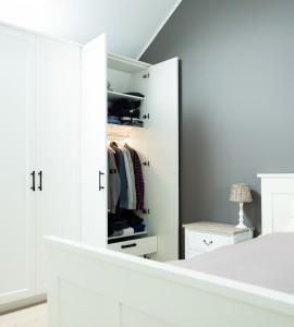 Slaapkamer met handgemaakte Dauby handgrepen